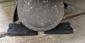 Showing a wheel on a grill with two Wobble Wedge plastic shims to stop the wheel from rolling, ie chock blocks