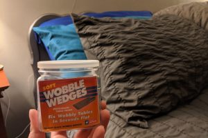 Use Wobble Wedge plastic shims to fix a creaking bed frame.